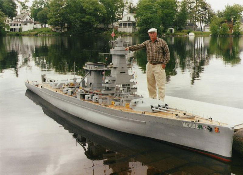 Man and his model of battleship